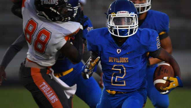 Travelers Rest junior running back Urijah Tucker (2) rushed for 92 yards and four touchdowns in the Devildogs' 33-6 win over Carolina Friday night..