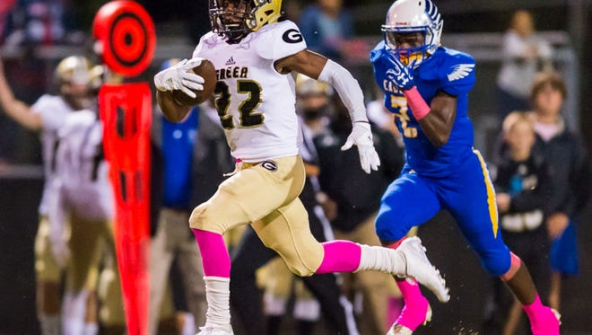 Sophomore running back Dre Williams (22) and the Greer Yellow Jackets held onto the No. 7 ranking in Class AAAA after their their fifth consecutive victory, 43-20 over Eastside.