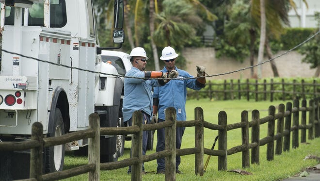 Utility crews repair damaged wires Oct. 7, 2016, in Vero Beach. Power outages across the Treasure Coast are shrinking, yet some phone and Internet customers remain frustrated over lack of service and answers from providers.