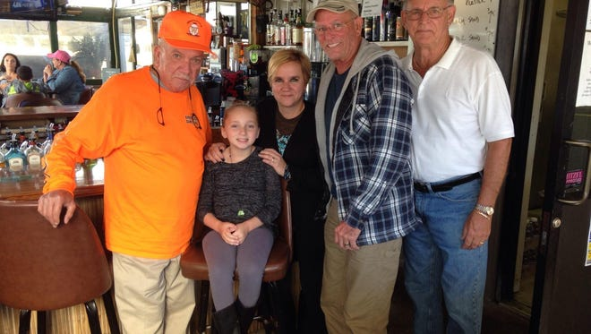 (From left) Ricky Fiocchi, proprietor of Uncle Ricky's Outdoor Bar & Grill, Gia Krumaker, Toni Krumaker, Gia's mother, Rob Shannon and Bob McKeon are pictured at Uncle Ricky's Outdoor Bar and Grill in Vineland, the last stop on Rob Shannon's 13th annual Poker Run. Proceeds from the poker run will benefit the Make a Wish Foundation and Gia, who is battling cancer.