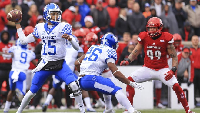 Former COD quarterback Stephen Johnson looks to throw against Louisville in the 2016 Governor's Cup.