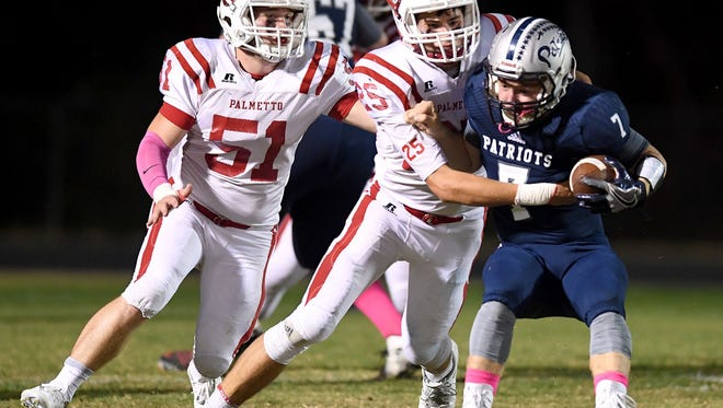 Junior linebackers Kenden Worth (51), Ben Cothran (25) and the Palmetto defense will face another strong running team when the Mustangs travel to Newberry Friday for a Class AAA third-round playoff game.