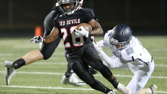 Junior running back Cavaugio Butler (26) and the Liberty Red Devils will play at Saluda in a Class AA third-round playoff game Friday night.