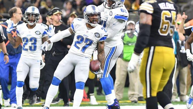 Detroit Lions safety Glover Quin celebrates intercepting a pass from Saints quarterback Drew Brees.