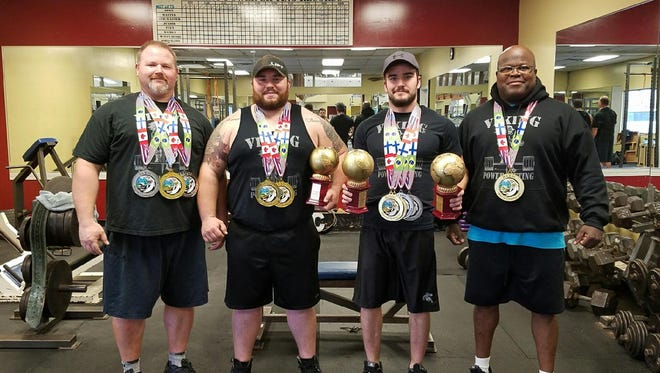 Dave Forstner, Ray, Voigt, Dylan Price and John Johnston pose with their medals and trophies from a recent event in Las Vegas.
