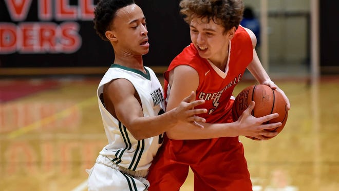 Greenville''s Wells Hoag, right, shown during first-round action, scored 12 points in the Red Raiders' 53-48 win against Beaufort in the C. Dan Joyner Poinsettia Classic semifinals Thursday night.