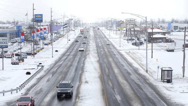 Snow covers South Campbell Avenue on Thursday morning.