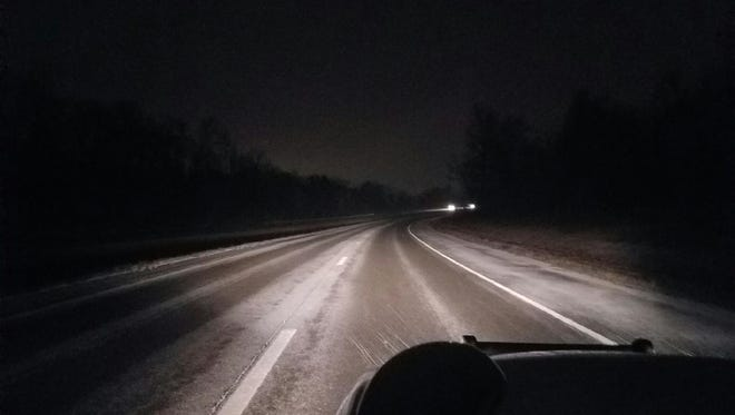 Light snow covered Purple Heart Parkway in Clarksville Thursday evening.