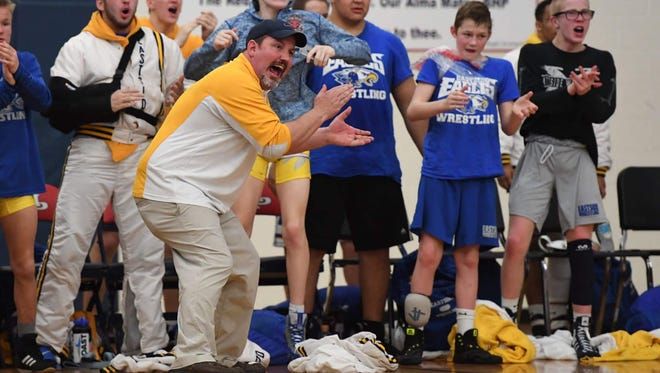 Eastside wrestling coach Jack Kosmicki and his Eagles react during Wednesday night's Class AAAA Upper State final against BHP. Eastside will take on Chapin in the state final Saturday.