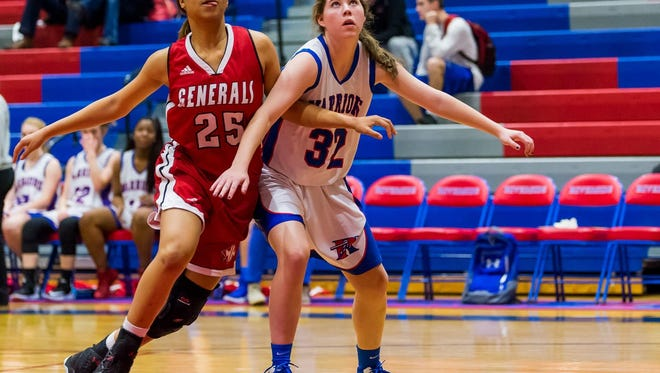 Wade Hampton's Erin Dillard (25), shown in a Feb. 10 game against Riverside, scored 12 points Friday night in the Generals' 44-34 Class AAAAA second-round playoff win over Nation Ford.