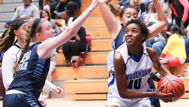 La'Imani Simmons (10) and the Woodmont Wildcats will travel to Dorman for a Class AAAAA third-round playoff game Monday night.