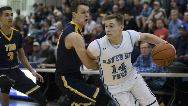 Mater Dei Prep's Kyle Cardaci dribbles to the basketball past Toms River North's Mike Nyisztor (center) as Toms River North's Holden Petrick (3) watches the action