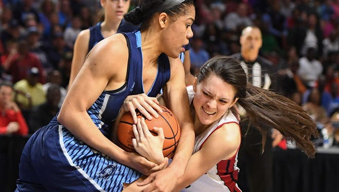 Wade Hampton's Alexis Guthrie, right, battles for possession of the ball with Dorman's Jazmyne Nelson during Saturday's Class AAAAA Upper State final at Bon Secours Wellness Arena. Guthrie and the Generals will play Goose Creek in the state final.
