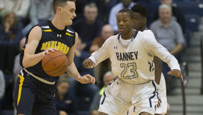 Marlboro's Dan Weiss (left) dribbles the ball as the Ranney School's Scottie Lewis (23) plays defense on the play. Both players were honored by the Shore Basketball Coaches Association today with first All-Division honors