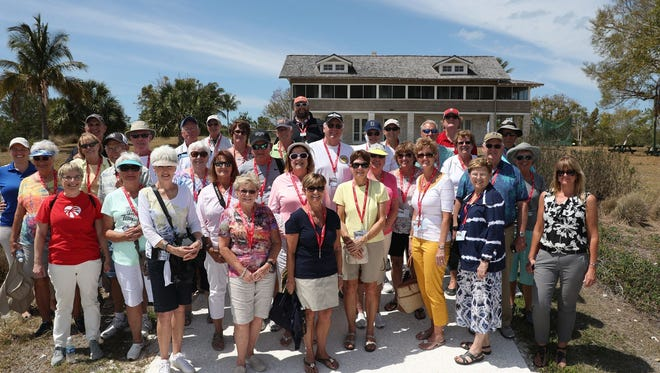 Group photo from The News-Press insiders boat tour with Pure Florida and the Mound House on Fort Myers Beach.