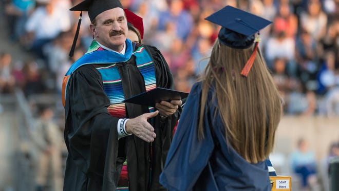 Superintendent/President Stan Carrizosa greets graduates during College of the Sequoias' 90th Commencement ceremony at Giant Chevrolet-Cadillac Mineral King Bowl on Thursday, May 25, 2017.