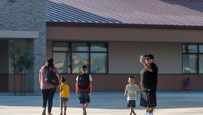 In this 2017 file photo, students and their families head to classrooms on the first day of school of Visalia's Riverway Elementary, the construction of which was partially funded by a voter-approved school bond.