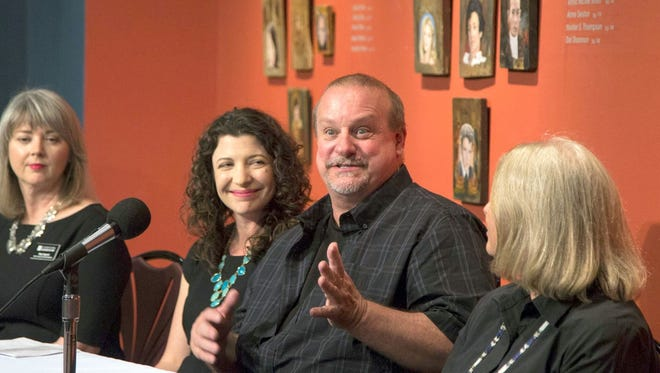"David Van Auker (second from right), the owner of the New Mexico antique shop who inadvertently purchased the Willem de Kooning's ""Woman-Ochre"" painting as part of an estate sale, answers questions during a press conference, Aug. 14, 2017, at the University of Arizona Museum of Art, 1031 N. Olive Road, Tucson."