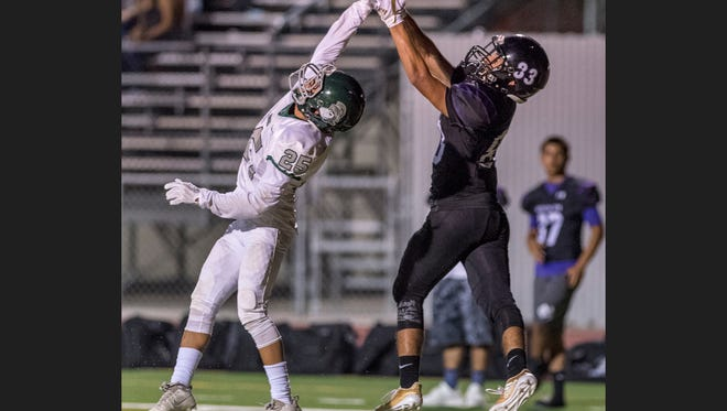 Dinuba's Josh Huerta, left, deflects pass intended for Mission Oak's Gonzalo Zamora in a non league football game at Mathias Stadium on Thursday, August 24, 2017.