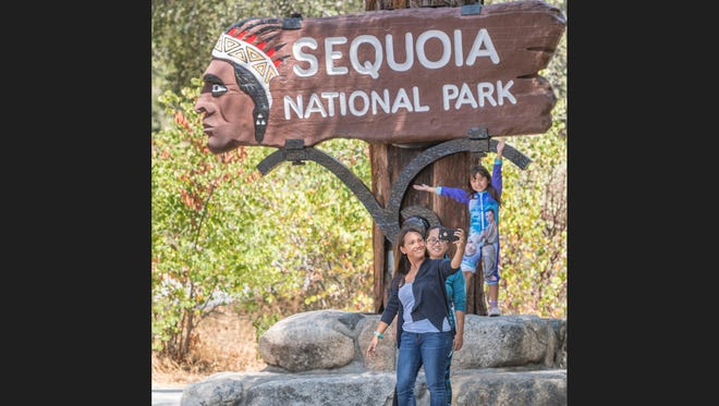 Sony Stewart, left, takes a selfie with her sister Rosny Hang and daughter Navi Stewart, 6, in Sequoia National Park on Friday, August 25, 2017. Entrance to the park was free in celebration of the 101st birthday of the National Park Service.