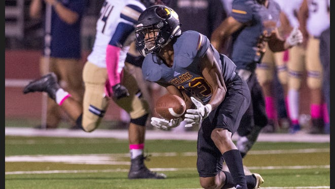 Tulare Union's Bryson Allen takes a pass against Delano in an East Yosemite League high school football game on Friday, October 13, 2017.