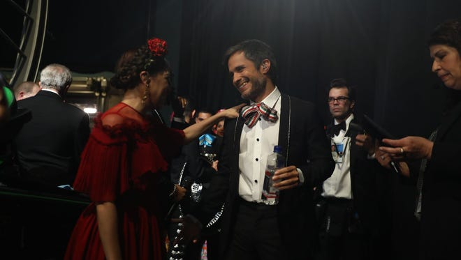 """Natalia LaFourcade y Gael Garcia Bernal relax after performing the winning original song, """"Remember Me,"""" from """"Coco."""""""