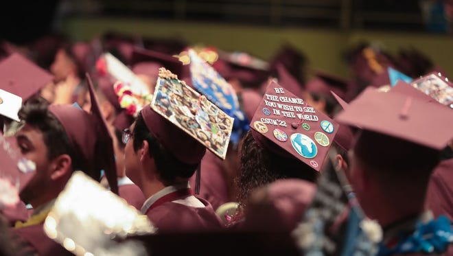 Class of 2018 graduates celebrate the next phase of their lives on their mortarboards.