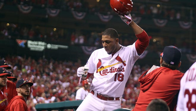 St. Louis Cardinals Oscar Taveras tips his helmet to the crowd after hitting a solo home run to tie the game in the seventh inning against the San Francisco Giants in Game 2 of the National League Championship Series at Busch Stadium on October 12, 2014. Molina left the game.