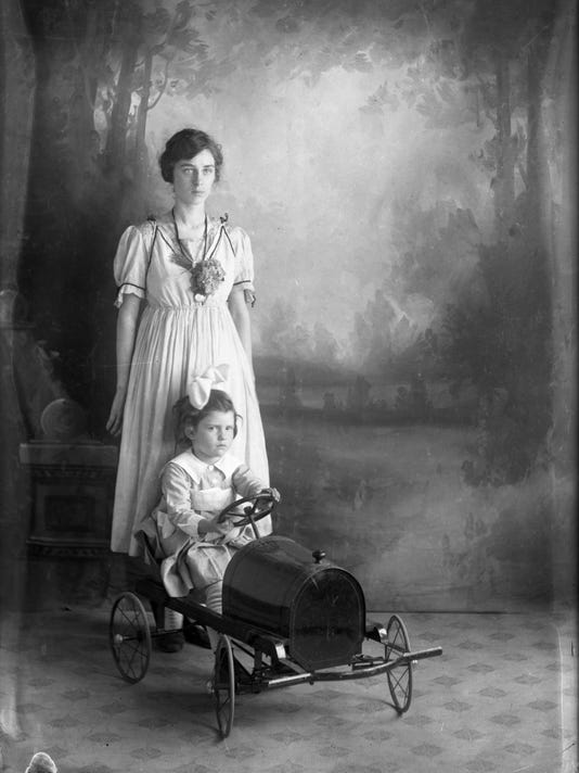 12. Young woman and child portrait