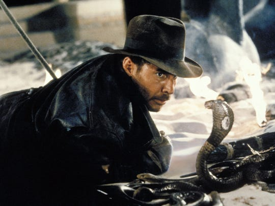 """Actor Harrison Ford comes face-to-face with a cobra in a scene from the Indiana Jones adventure """"Raiders of the Lost Ark."""""""