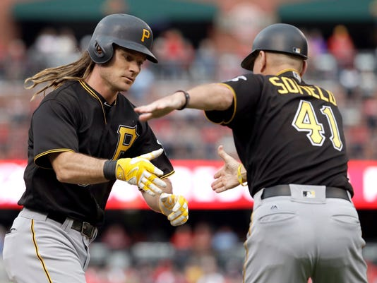 Pittsburgh Pirates' John Jaso, left, is congratulated by third base coach Rick Sofield while rounding the bases after hitting a two-run home run during the seventh inning of a baseball game against the St. Louis Cardinals, Sunday, Oct. 2, 2016, in St. Louis. (AP Photo/Jeff Roberson)