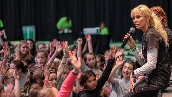 MSU Head Womens Basketball Coach Suzy Merchant talks to young girls about gratitude during a morning session at the EmpowHER event held at the Breslin Center Saturday, April 28, 2018.