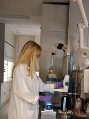 Kaley Adams runs laboratory tests to ensure that treatment is meeting water quality standards.
