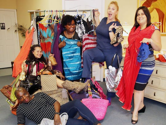 Marie McKenzie, Mindi Fetterman, Paula Hosein, Rio Ratermanis, and Carissa Zerga  prepare for the fifth annual Inner Truth Project's Fall into Fashion Clothing Swap on Oct. 14 at Reserve Park Trace #13 in Port St. Lucie.