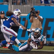 Kelvin Benjamin catches a touchdown pass at Bank of America Stadium Friday night.