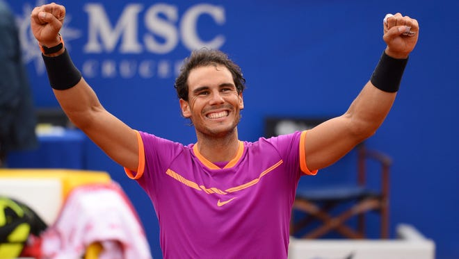 Rafael Nadal celebrates his victory over Dominic Thiem at the Barcelona Open.
