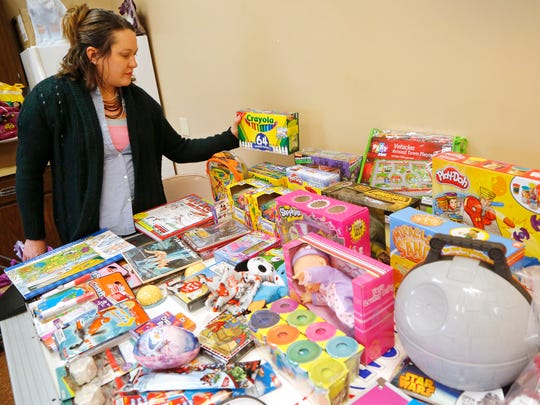 Amy Hilt picks out toys provided by Special Parents-Special