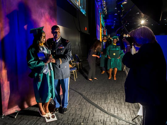 Second Lt. Artist Jones and his fiancŽe Loveleigh Goode get their photo taken following a surprise proposal during graduation ceremonies for Wilmington University at the Chase Center on the Riverfront in Wilmington on Sunday afternoon.