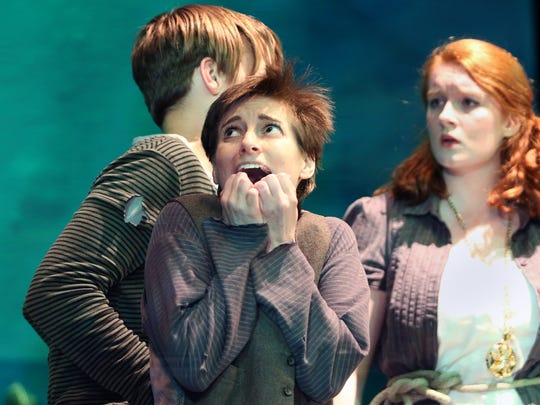"A terrified Ted (Sasha Alamano, left) draws the concern of Molly Aster (Orla Budge) during a rehearsal for Bremerton Community Theatre's ""Peter and the Starcatcher."""