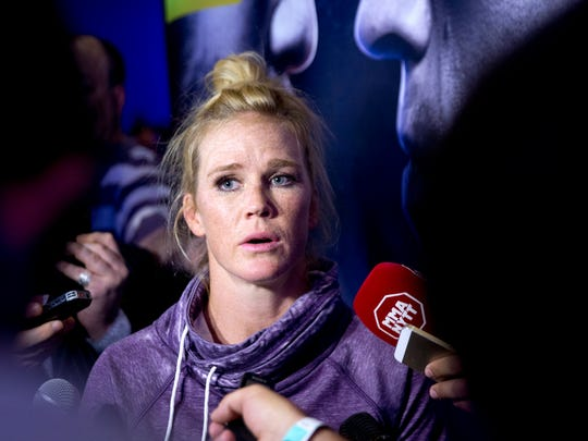 UFC women's bantamweight champion Holly Holm talks with reporters March 2 during open workouts for UFC196 at the MGM Grand in Las Vegas, Nev.