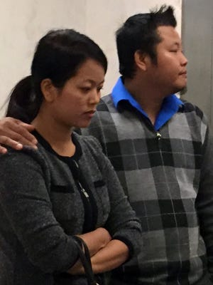 Khin Par Thaing and a man believed to be her husband leave court after she pleaded guilty to battery Oct. 28, 2016, in Indianapolis.