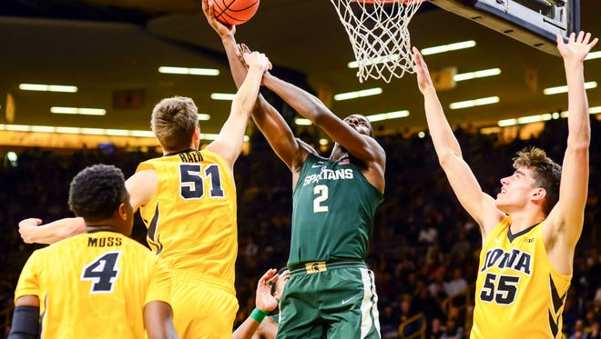 Michigan State Spartans forward Jaren Jackson Jr. (2) goes to the basket as Iowa Hawkeyes forward Nicholas Baer (51) and forward Luka Garza (55) and guard Isaiah Moss (4) defend during the first half at Carver-Hawkeye Arena.