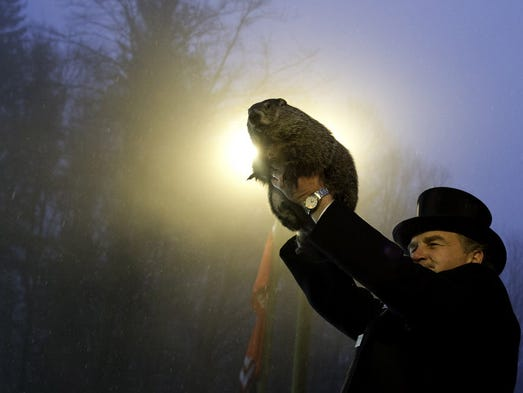 Groundhog handler John Griffiths holds Punxsutawney