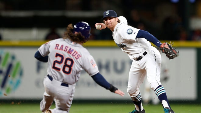 Seattle Mariners shortstop Brad Miller, right, completes the double play, getting Houston Astros' Colby Rasmus out at second during the seventh inning of baseball game Wednesday, April 22, 2015, in Seattle. Jake Marisnick was out at first. )