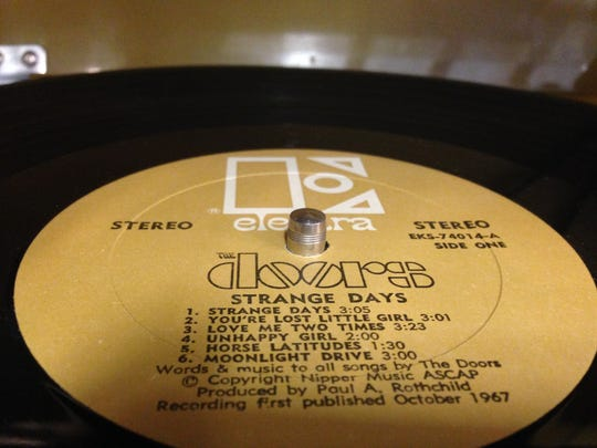 """The Doors album """"Strange Days""""  was on the turntable Monday at Four Quarters Brewing in Winooski, where music is key to beer-making."""