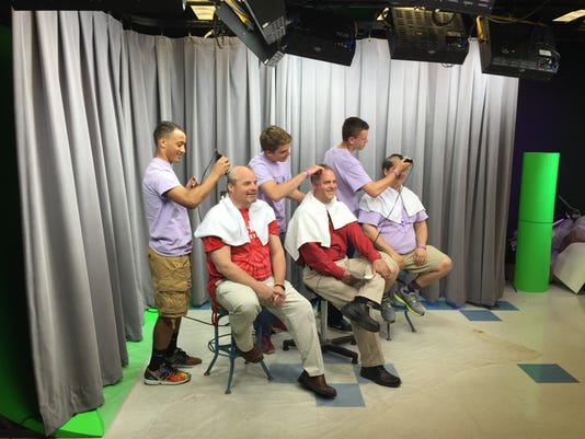 Pal-Mac officials take haircuts for player battling cancer