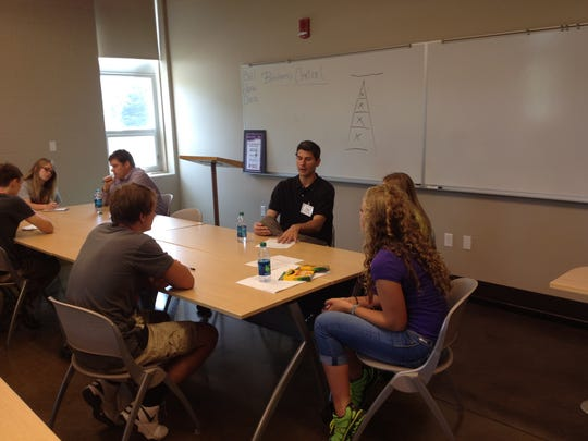 The Iowa Newspaper Foundation sponsors a media track at the Business Horizons program. Students from the 2014 class are pictured.