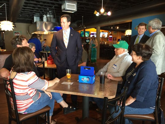 Former Sen. Rick Santorum meets with the owners of Quirks Grill and Bar, a restaurant he spoke at Sunday afternoon.