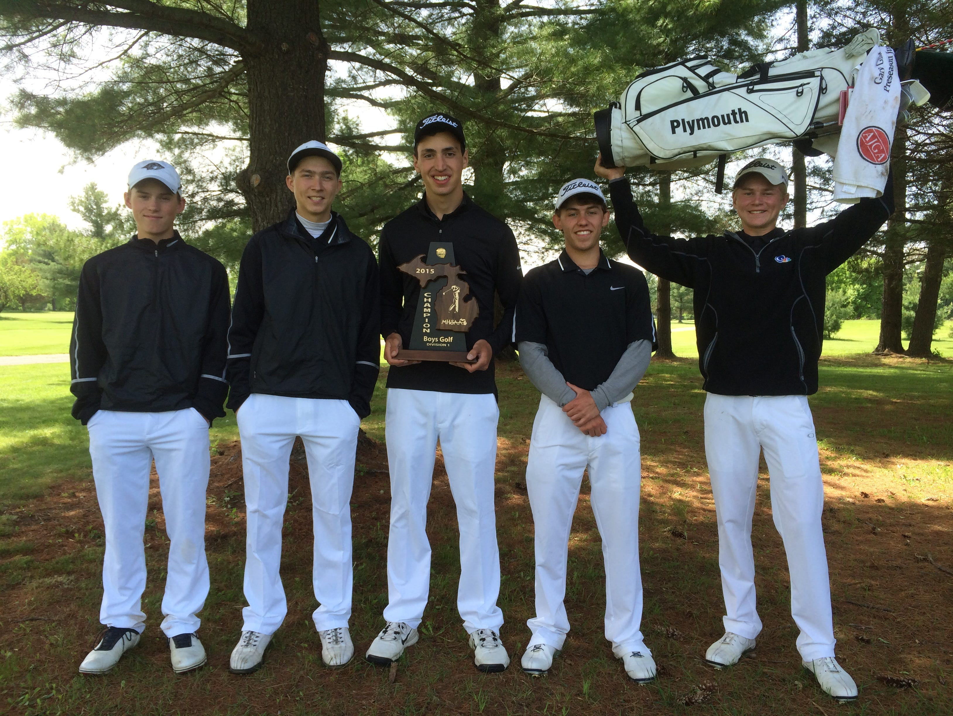 Plymouth's varsity boys golf team celebrates after winning Wednesday's Division 1 district at Pine View Golf Course in Ypsilanti.