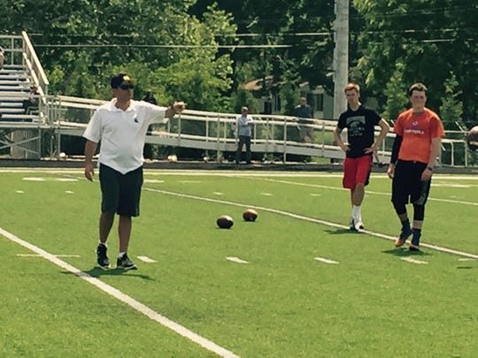 Jedd Fisch works with players in Indianapolis.